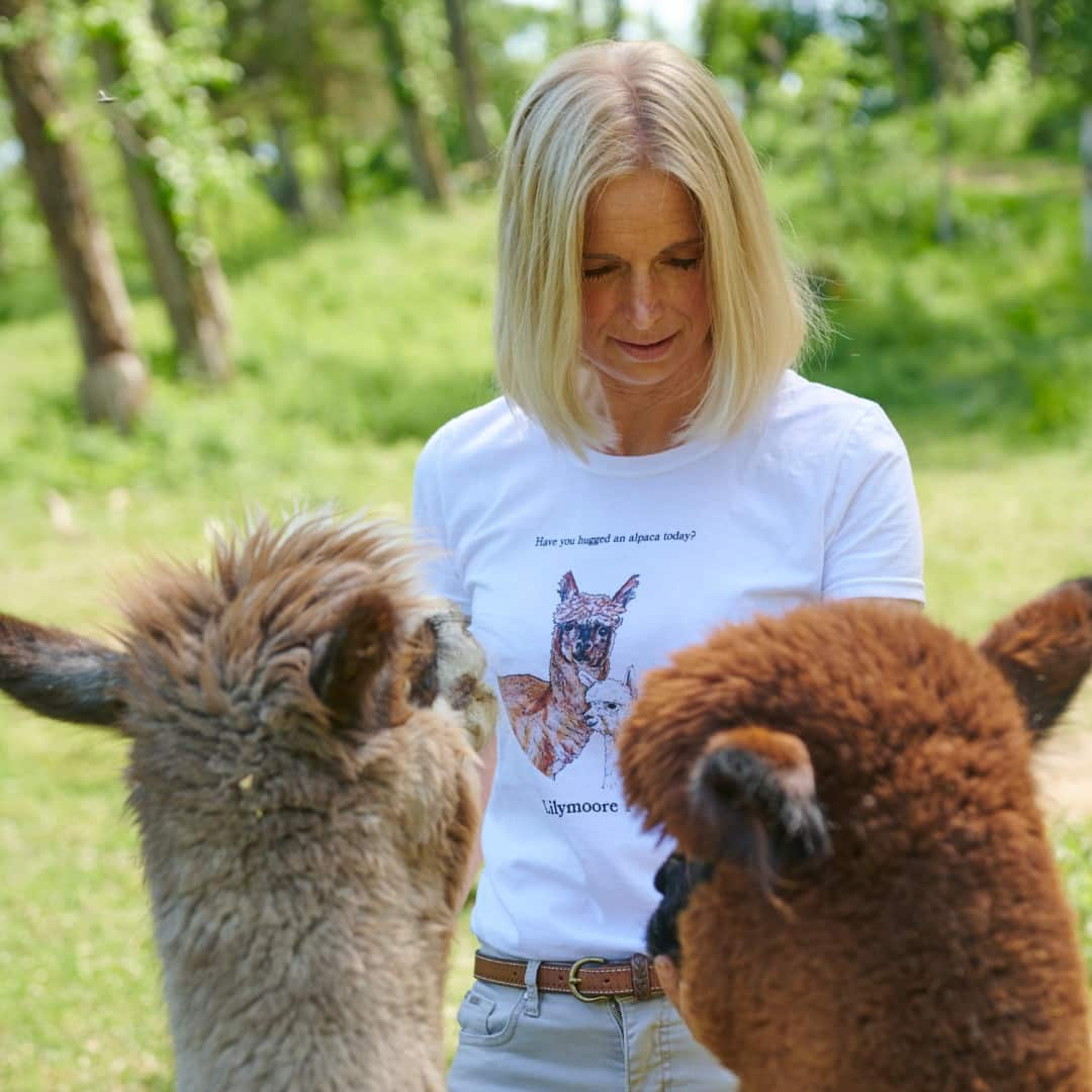 Diana feeding some alpacas